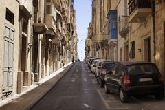 One of the old, historical streets in Valletta. / Malta. Image shows architectural style of the city and lifestyle. It`s the capital of the Mediterranean island Royalty Free Stock Photography