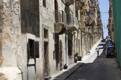 One of the old, historical streets in Valletta. / Malta. Image shows architectural style of the city and lifestyle. It`s the capital of the Mediterranean island Stock Image