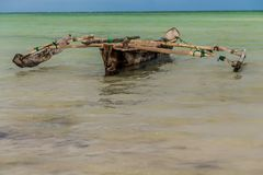 One old homemade wooden boat in  the ocean against the horizon. At good weather and no people royalty free stock photography