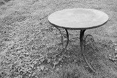One old iron table is located on a lawn Stock Images