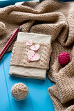 One old notebook in knitted cover with felt hearts Stock Images