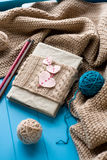 One old notebook in knitted cover with felt hearts Royalty Free Stock Photography
