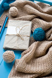 One old notebook in knitted cover lie next to the coil Stock Photo