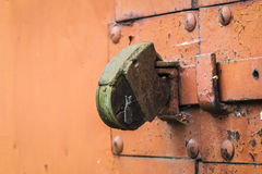 One old rusty door lock brown background with copy space. Old rusty background metal wall with spider nets Stock Photo