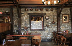 One of the old stone wall dining rooms in the famous Old Bryan Inn Restaurant,Saratoga Springs,New York,2015 Royalty Free Stock Photo