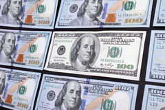 One old type hundred dollar banknote among new ones Stock Photos