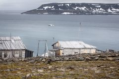One of oldest polar stations in Arctic. Franz Josef Land. Severe land. One of the oldest polar stations in Arctic founded in 1928, now abandoned. Wooden houses stock photos