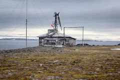 One of oldest polar stations in Arctic. Franz Josef Land. Severe land. One of the oldest polar stations in Arctic founded in 1928, now abandoned. Wooden houses stock photo