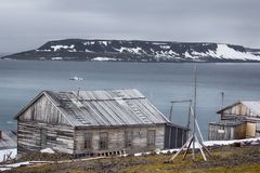 One of oldest polar stations in Arctic. Franz Josef Land. Severe land. One of the oldest polar stations in Arctic founded in 1928, now abandoned. Wooden houses royalty free stock photo