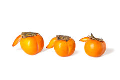 One by one persimmons  on white Stock Photos