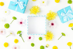 One open blue gift box with chrysanthemums. flat lay Stock Images