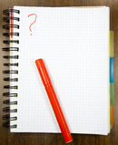 One open notebook. With red felt-tip pen on table stock photography