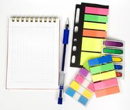 One open notebook with stickers. One open notebook with pen and set off colored stickers royalty free stock image