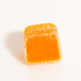 One orange candie Stock Photos