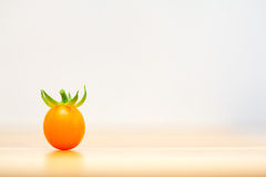 One orange cherry tomato Stock Photos