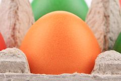 One orange easter egg at cardboard Stock Image