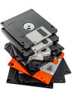 Only one orange floppy disk in row.  Stock Image