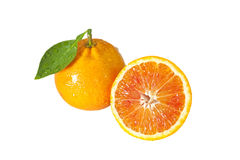 One orange with half. Closeup studio photo of one orange with half nice and juicy full of water drops isolated on white background Stock Photos