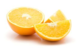 Orange, appelsin isolated. One orange half and two sliced quarters isolated on white background Stock Photo