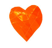 One orange paper heart shape. On a white background Stock Photography