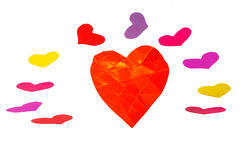 One orange paper heart shape with roundelay. From colored heart shapes Stock Photography
