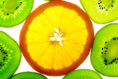 One orange slice with many kiwi slices Stock Images