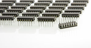 One out of order (closeup). Microchips odered like army unit with one upside-down (closeup Stock Photography