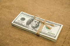 One pack of dollars on an old cloth Stock Images