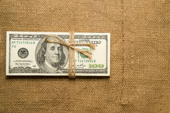 One pack of dollars on an old cloth Royalty Free Stock Images