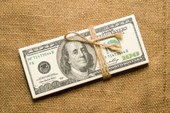 One pack of dollars on an old cloth Royalty Free Stock Photography