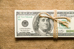 One pack of dollars on an old cloth Stock Image