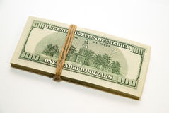 One pack of dollars on over white Stock Image