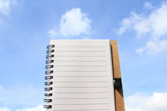 One page notebook on the background of sky Royalty Free Stock Images