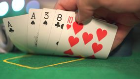 One pair, aces, poker cards. One pair, aces, close up. Man reveal lucky combination. Poker hand of five cards: one pair of cards same rank - aces, other three stock footage