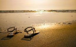 One pair of shoes on the beach. One pair of shoes on the beach Stock Photos