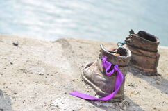 One pair of shoes on the Danube Bank. Purple chenille on the children shoe,one of the memorial shoes on the Danube Bank Stock Images