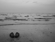One pair of shoes. That had been left on the beach is empty form thailand Royalty Free Stock Image