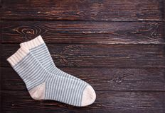 One pair white socks with light blue strip on a wooden background Royalty Free Stock Photos
