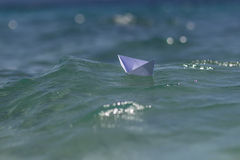 One paper boat in sea Royalty Free Stock Photos