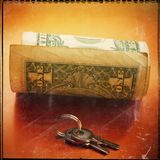 One paper dollar and keys on golden background. Web banner. Royalty Free Stock Images