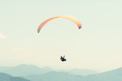 One paraglider in the sky over the hills line. On a sunny day Stock Photography