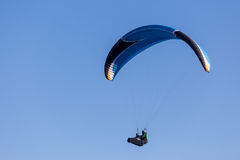 One paragliding in the sky. One paragliding in a clear sky Stock Image