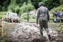 One of the participants of the race walking through the deep mud. Royalty Free Stock Photo