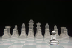 One pawn against many enemies. Shallow depth of field Royalty Free Stock Photography