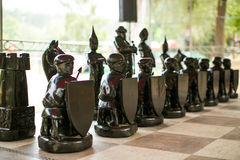 One pawn staying against full set Royalty Free Stock Photo