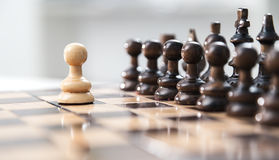 One pawn staying against full set of chess pieces. Royalty Free Stock Photos