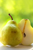 One pear and a half Royalty Free Stock Images