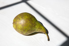 One pear on the table Stock Images