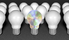 One pearl light bulb among many white ones on grey textured background Stock Photos
