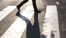 One pedestrian crossing the street Royalty Free Stock Image